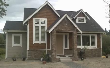 Leonid Milkin's Rebuilt Home on Same Lot